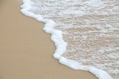 Soft wave of sea on the sand beach royalty free stock photos