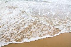 Soft wave of sea on the sand beach stock photos