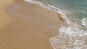 Soft wave of the sea. On the sandy beach stock footage