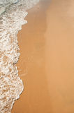 Soft wave of the sea on the sandy beach Royalty Free Stock Images
