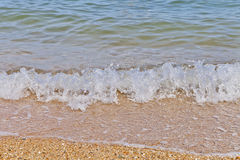Soft wave of the sea on the sandy beach. The Soft wave of the sea on the sandy beach Stock Photos