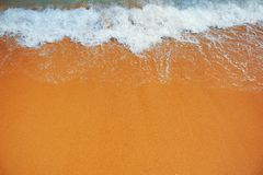 Soft wave of the sea on the sandy beach Stock Images