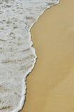 Soft wave of the sea on sandy beach Stock Photos