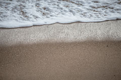 Soft wave of the sea on the sandy beach Royalty Free Stock Image