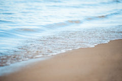 Soft wave of the sea on the sandy beach Royalty Free Stock Photography