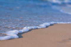 Soft wave of the sea on a sandy beach Royalty Free Stock Photo
