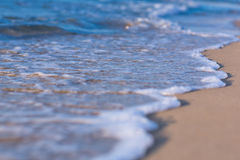 Soft wave of the sea on a sandy beach Stock Photos