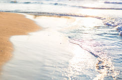 Soft wave of the sea on a sandy beach Royalty Free Stock Image