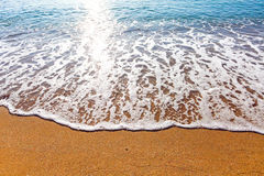 Soft wave of the sea on the sandy beach Royalty Free Stock Photo