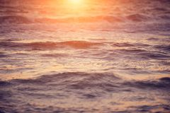Soft wave of sea at sunset. Soft wave of sea at warm gold sunset light. Selective focus Royalty Free Stock Images