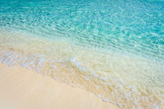 Soft wave of the tropical sea on the sandy beach Stock Photography