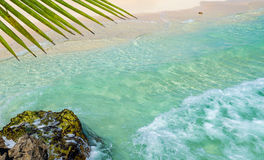 Soft wave of the tropical sea on the sandy beach. Caribbean Sea Royalty Free Stock Image