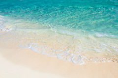 Soft wave of the turquoise sea on the sandy beach. Natural summe Royalty Free Stock Images