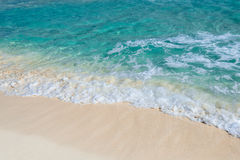 Soft wave of the turquoise sea on the sandy beach Stock Photo