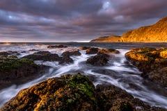 Soft Waves. Crashing on the Rock stock photography
