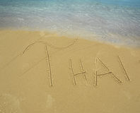 Soft waves and the inscription on the sand. Beach blue sea and the inscription on the sandy shore Stock Image