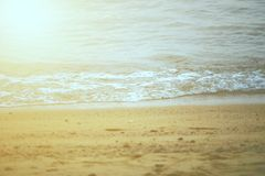 Soft waves of the sea on the sand beach. Selective Focus royalty free stock images