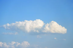 Soft white clouds against blue sky Stock Photos