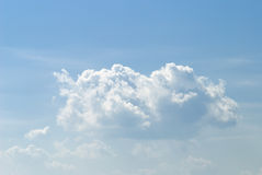 Soft white clouds against blue sky Stock Images