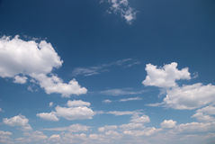 Soft white clouds against blue sky Stock Photography