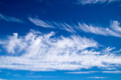 Soft white clouds on blue sky Stock Images