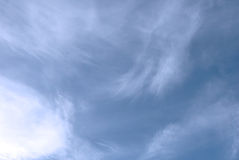 Soft white fluffy clouds against a blue sky Stock Photos