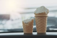 Soft white milk cream ice cream cone in the cone. In the car in summer day Royalty Free Stock Images