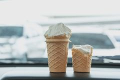 Soft white milk cream ice cream cone in the cone. In the car in summer day Stock Photography