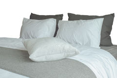 Soft white pillows and comfortable bed on white background Stock Photo