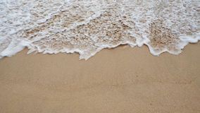Soft white wave of the sea on the sandy beach at Phuket, Thailand. Copy space for some text Stock Photo
