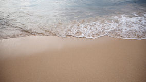 Soft white wave of the sea on the sandy beach at Phuket, Thailand. Copy space for some text Stock Photos