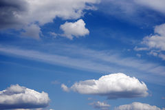 Soft wispy clouds over the blue sky. Soft feather clouds over the blue sky royalty free stock photography