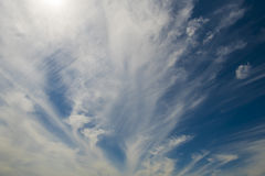 Soft wispy clouds over the blue sky. Soft feather clouds over the blue sky stock images