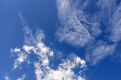 Soft wispy clouds over the blue sky. Soft feather clouds over the blue sky stock photo