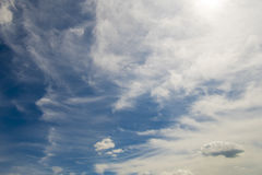 Soft wispy clouds over the blue sky. Soft feather clouds over the blue sky stock image