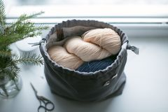 Soft wool and christmas bouquet. Soft wool are in bag with christmas bouquet in winter in the light day Royalty Free Stock Photos