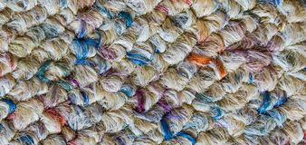 Soft wool floor fabric covering with different colors in macro close up background texture royalty free stock photo