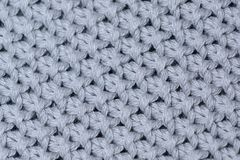 Soft wool knitted fabric texture, close up photo. A background image. stock image