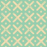 Soft yellow polka dots and crosses with textured chalk effect. Bright seamless geometric vector pattern on mint green stock illustration