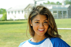Softball 1. Beautiful young woman in baseball shirt smiling in bright summer sun stock images