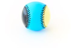 Softball. A ball for softball, on a white background, sharp foreground, blurred background Royalty Free Stock Photos
