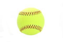 Softball. Yellow softball set on a white background Stock Image