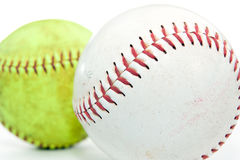 Softball. Closeup of two softballs on a white background. One white and one yellow Stock Photography