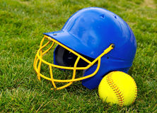 Softball. Batter's helmet and  on grass Stock Images