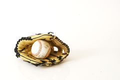 Softball. Glove and ball isolated on a white background Royalty Free Stock Photography