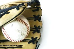 Softball. Glove and ball on a white background Royalty Free Stock Photos