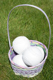 Softball balls in a easter basket Royalty Free Stock Images