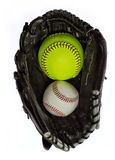 Softball and baseball in a glove Royalty Free Stock Images