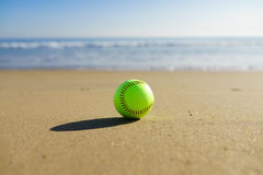 Softball at a California beach with white wave in Pacific Ocean Stock Photo