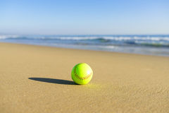 Softball at a California beach with white wave in Pacific Ocean Stock Photography